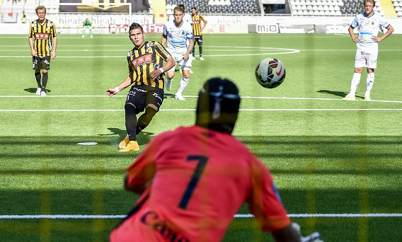 Zuta, in the back, watches his teammate convert a penalty